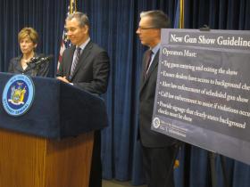 Schneiderman (center) details new regulations for New York gun shows.
