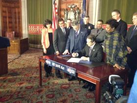 Governor Cuomo signs the NY SAFE Act.