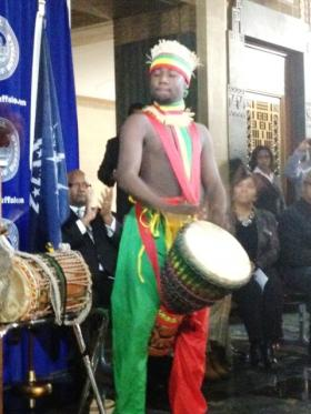 Member of the African American Cultural Center providing music and dance in the lobby of City Hall
