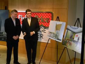 Fisher-Price VP David Allmark and Kaleida Health President/CEO James Kaskie unveil the new plans.