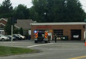 Emergency crews at the corner of Harris Hill & Main Street near the crash site Wednesday