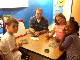 Chad White, UB student teacher with students.