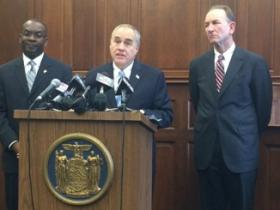 DiNapoli, flanked by Mayor Byron Brown and Comptroller Mark Schroeder, says Buffalo's finances are improving.