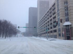 The cold and snowy weather whips through downtown Buffalo.