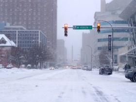 Snowy morning in downtown Buffalo as citizens and businesses try to return to normal schedules.
