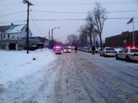 Buffalo Police outside Harvey Austin School on Sycamore (right of photo) as they searched for possible person with gun.