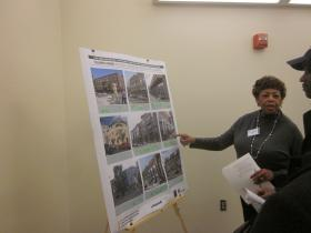Citizens review photos of the future of Central Park Plaza.