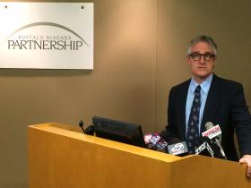 TRIP's Rocky Moretti appears at the Buffalo Niagara Partnership Wednesday to discuss condition of roads.