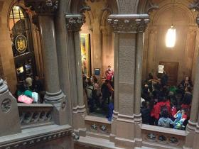 Protesters outside Governor Cuomo's office called for more education funding.