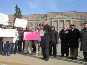 Supporters, including former State Senator Antoine Thompson, rallied in front of Bennett High School Monday.