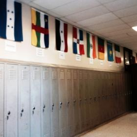World flags line the hallway inside Lafayette High School to represent the many different countries of the school's student population.