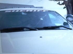 A bullet hole on the hood of an Erie County Sheriff's car.