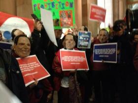 Protesters with Cuomo masks rally in Albany