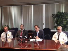 U.S. Attorney William Hochul (second from right) outlines the plea taken by former police officer Patrick O'Mara.