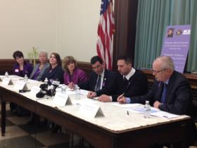 Survivors and family members of domestic violence, Senator Mark Grisanti, Executive Director of Family Justice Center Mary Travers Murphy and David Wisniewski.