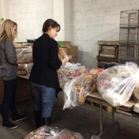 Buffalo Dream Center volunteers package pastries and breads for needy families in the city.