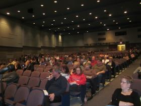 A small crowd of community members gathered at Kenmore East High School Tuesday night to hear the school board's decision to close three schools.