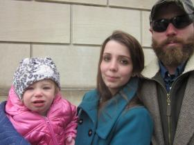 State Senate candidate Gia DeGennaro Arnold attended the rally with her husband and child.