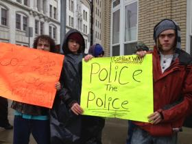 A dozen people rallied against alleged police brutality.