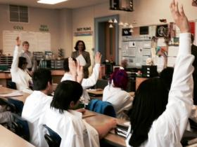 8th grade School 19 students in a STEM program raise their hands when asked if they are planning to go to college.