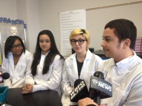 8th graders, Jesus Vidal (right to left), Mika Durgan, Jully Bui & Daysia Ford talk about careers in medicine and science.