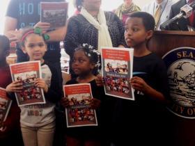 Students from PS #32 Bennett Park Montessori help Mayor Brown kick-off summer reading challenge.