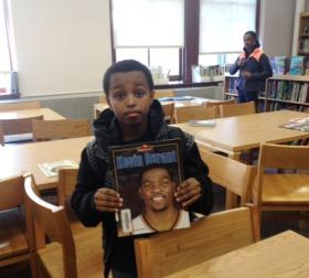 Ernyes, a 4th grader at Bennett Park, shows off the book he is reading.