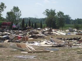 The house explosion in July 2012 caused the death of 14-year-old Sarah Johnson.