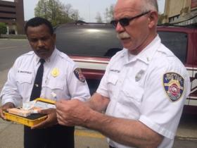 Fire Commissioner Garnell Whitfield and Lt. Rick Hanes-Stetter show the Narcan kits now equipped on department vehicles.