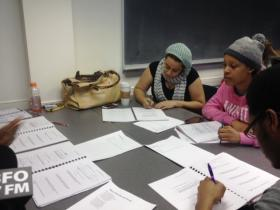 Canisius students discuss the sounds of poems.