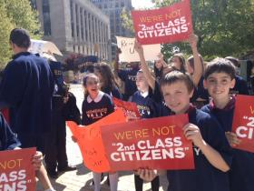 Students from St. Andrew's Day School in Kenmore join the rally in Niagara Square.