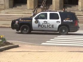 Buffalo Police Commissioner Daniel Derenda in Buffalo Police vehicle in front of City Hall following news briefing.