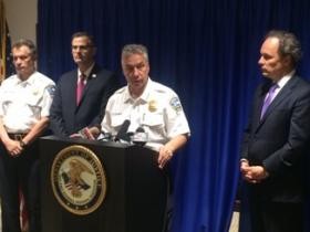 Police Commissioner Daniel Derenda (c.) and U.S. Attorney William Hochul (r.) outline the charges against the three officers.