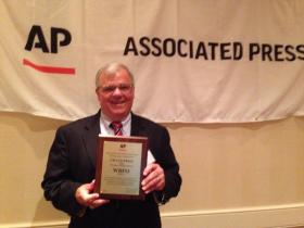 Mark Scott holds the Flanders Award for WBFO. Mark traveled to the AP awards in Saratoga Saturday to bring home the WBFO awards.
