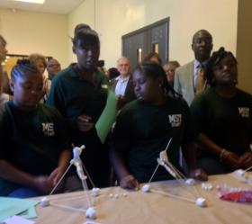 MST School students demonstrate their marshmallow launchers from STEM learning program.