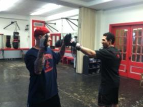 Shawn McConnell and Pietro Muscato train with focus mitts during a workout at KC's Fitness.