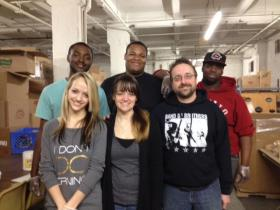 Pastor Eric Johns standing with Buffalo Dream Center volunteers