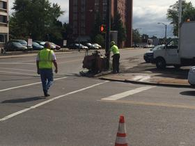 Workers in Buffalo prepare the corner of Kenmore Ave and Colvin Blvd for repaving.