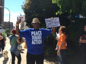 Protestor demonstrates the focus of the peaceful rally.