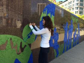 Tape Art Executive Director Kristen Carbone working on the public mural.