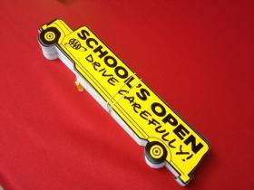 """School's Open -- Drive Carefully"" campaign bumper stickers."