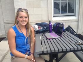 Megan Messer is a second year UB student siting outside on the South Campus in Buffalo.