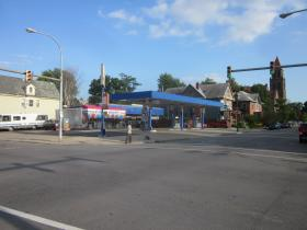 A shuttered gas station at Elmwood and Delavan that Ellicott Development wants to convert into a multi-use building, likely including a restaurant.