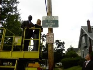 Kathy Russert Hughes with Mayor Byron Brown unveiling sign in honor of her brother