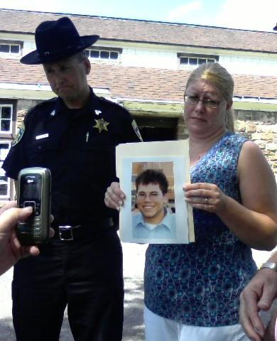 Kelly Kline of West Seneca holds photo of her son killed in a texting while driving crash