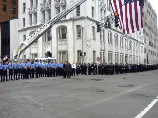 Firefighters line Franklin Street near St. Joseph Cathedral