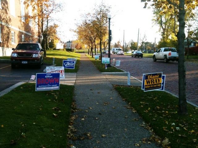 Various campaign lawn signs  outside polling site at University Presbyterian Church at Main Street  & Niagara Falls Blvd.