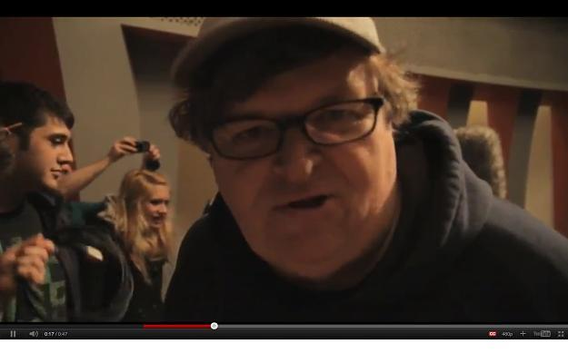 Filmmaker Michael Moore encourages Occupy Buffalo to hang in during winter time