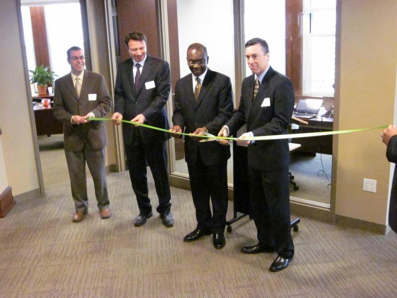 Mayor Byron Brown (second from right) joins in the ribbon cutting ceremony officially opening Business Technology & Resource Group's U.S. headquarters in downtown Buffalo.