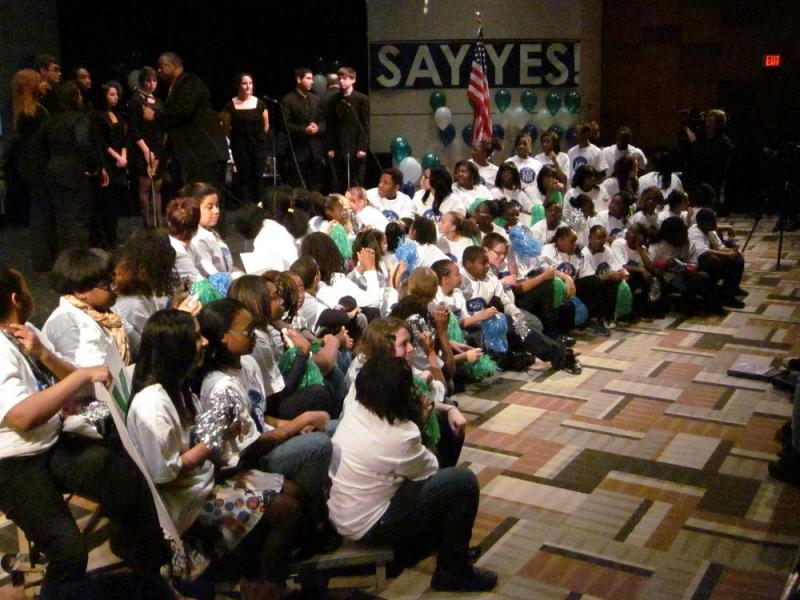 Students sit at the front of the auditorium as they and hundreds of classmates cheered in a pep rally styled celebration, during which Say Yes to Education announced it is funding free college tuition and other services for Buffalo public school students.